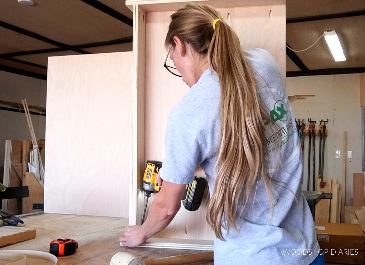 Installing toe kick board into cabinet box