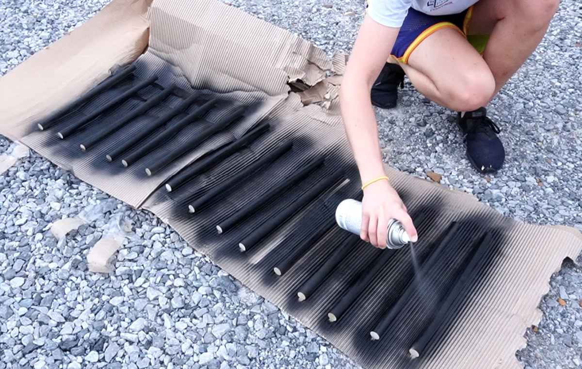 Spray painting dowels to use as outdoor chair rails