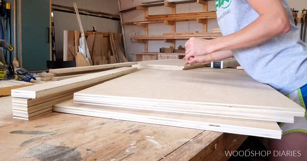 All plywood parts laid out on workbench ready to assemble basic wooden dog crate cabinet