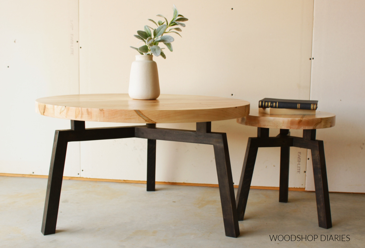 Big and small black and wood modern DIY round coffee tables together with floating top