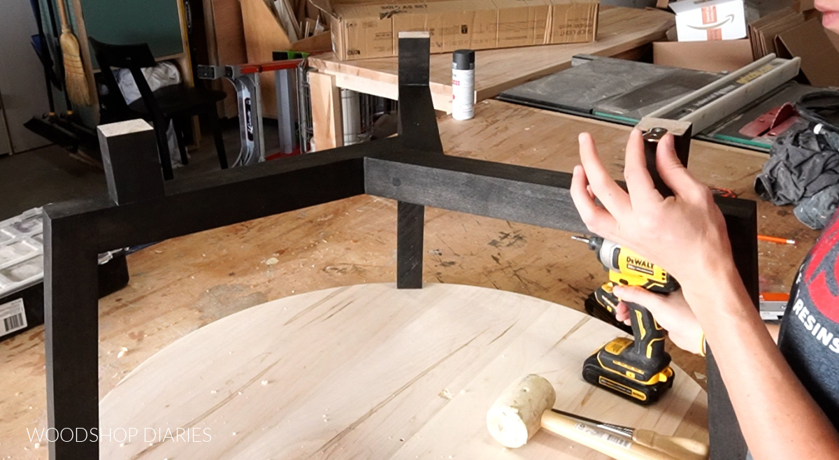 Attaching figure 8 fasteners to risers on round coffee table base