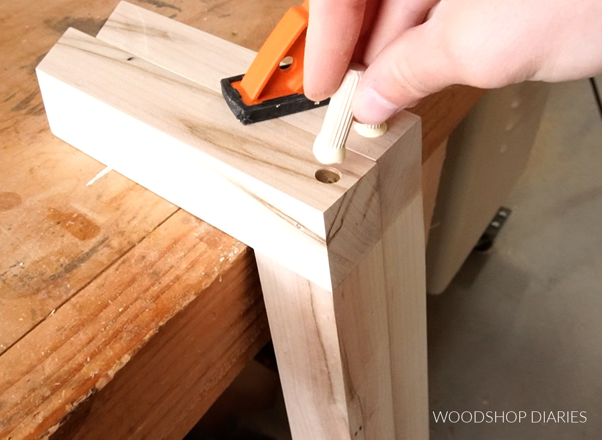 Close up of plugging screw holes in coffee table legs