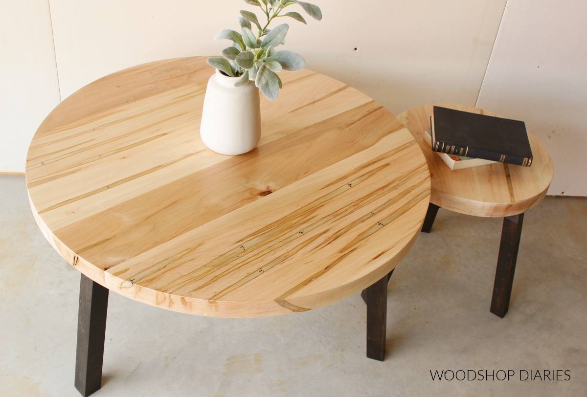 Overhead view of round wooden coffee tables--one large and one small side by side