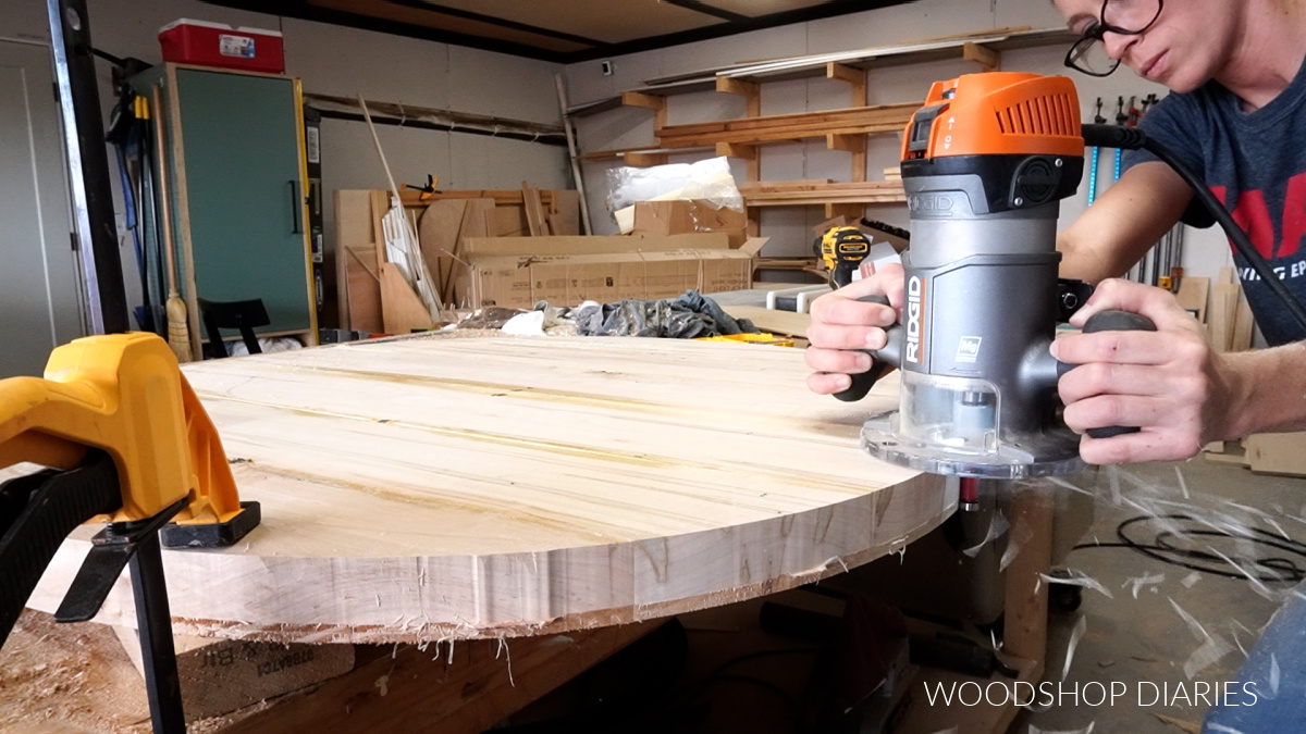 Router and flush trim bit smoothing out coffee table top edges